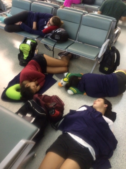<p>Well maybe not the whole world, but halfway wasn't so bad in over a day and a half. The team caught a nap during a flight delay in Shanghai before heading to Sanming on Tuesday.</p>