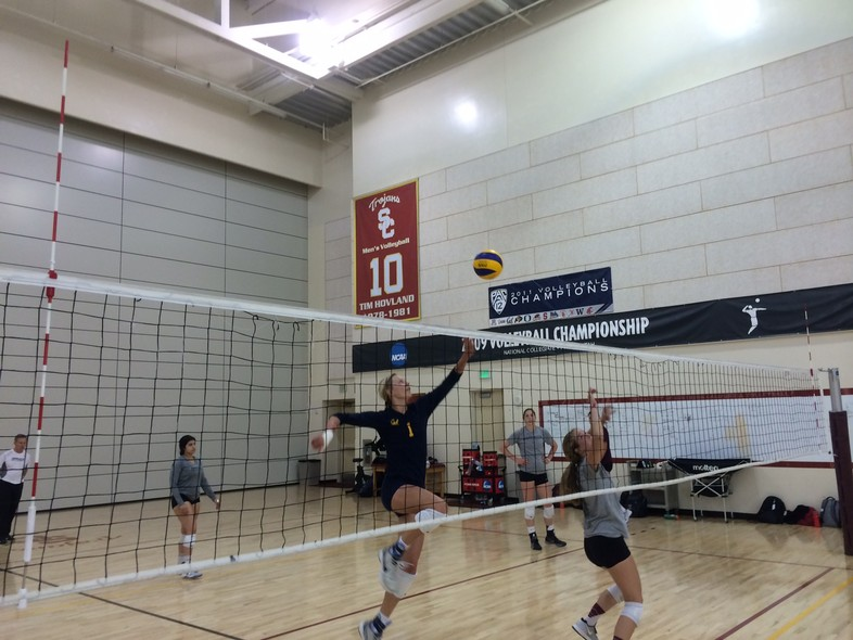 <p>Cal's Lillian Schonewise went for a kill after a set by Stanford's Madi Bugg Saturday during practice at USC.</p>