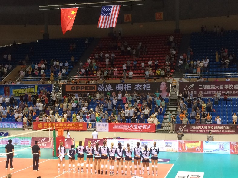 """<p>The Pac-12 women's volleyball all-star team stood at attention for the national anthem prior to their first match in ChinaWednesday in Sanming. More than 3,000 watched as the Pac-12 team <a href=""""http://pac-12.com/article/2014/06/18/despite-long-journey-pac-12-volleyball-all-stars-win-first-match"""" target=""""_blank"""">defeated Fujian 25-23, 20-25, 25-23, 25-17</a>.</p>"""