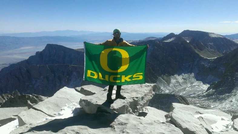 On top of Mount Whitney with the Duck flag.