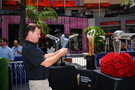Jim Mora checks out the hardware at Pac-12 Football Media Days.