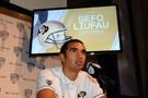 Colorado quarterback Sefo Liufau addresses the media at the podium.