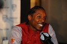 USC WR/DB Adoree Jackson gives reporters a smile at the podium.