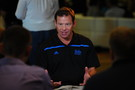 UCLA head coach Jim Mora chats with reporters at Media Day.