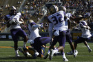 "<p><a href=""http://pac-12.com/article/2014/10/11/washingtons-shaq-thompson-returns-fumble-100-yard-touchdown"">Shaq Thompson did what Shaq Thompson does</a>, and the Huskies put forth one of the <a href=""http://pac-12.com/videos/recap-washington-football-overpowers-california"">most impressive defensive efforts of the conference season Saturday</a> to take down a hot Bears squad that had put up 119 points the previous two weeks. Cyler Miles threw for 273 yards and three touchdowns for the Huskies, who are tied for first in the Pac-12 North. <a href=""http://pac-12.com/football/event/2014/10/18/washington-oregon"">UW travels south to Eugene next week</a>, while the Bears host a <a href=""http://pac-12.com/football/event/2014/10/18/ucla-california"">Bruins squad desperate for a win.</a></p>"