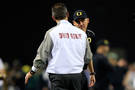 <p>Head coaches Mark Helfrich and Urban Meyer meet on the field pre-game.</p>