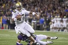 """<ul><li><a href=""""http://pac-12.com/ucla-football-brett-hundley-vs-washington"""" style=""""line-height: 1.6em;"""">Brett Hundley led the surging Bruins</a>to their fourth straight win Saturday</li> <li><span style=""""line-height: 1.6em;"""">In a game featuring two of the best two-wayplayers in the country, </span><a href=""""http://pac-12.com/myles-jack-spin-move-ucla-vs-washington"""" style=""""line-height: 1.6em;"""">UCLA's Myles Jack got the best of Shaq Thompson</a></li> <li><a href=""""http://pac-12.com/john-ross-kickoff-return-washington-football"""" style=""""line-height: 1.6em;"""">Washington's John Ross returned a kick for 100 yards</a> and six pointsin the third quarter</li> </ul>"""