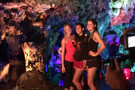 <p>Cal's Lillian Schonewise, USC's Samantha Bricio and Stanford's Brittany Howard took a moment to pose in front of a wall of color during a tour of the Yuhua Cave near Sanming on Friday.</p>