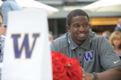 <p>Husky defensive back Sean Parker flashes a smile at Pac-12 Football Media Day.</p>