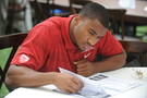 <p>Cougs' safety Deone Bucannon studies at media guide on the Sony Pictures Studios lot.</p>