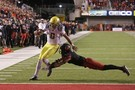 """<ul><li><a href=""""http://pac-12.com/videos/highlights-marcus-mariota-carries-no-4-oregon-past-no-17-utah"""">Oregon reeled off 24 consecutive points</a> after a Utah flub to secure a win and <a href=""""http://pac-12.com/article/2014/11/08/pac-12-football-championship-game-oregon-clinches-pac-12-north"""">the North Division title</a>Saturday</li> <li><a href=""""http://pac-12.com/videos/oregon-football-marcus-mariota-florida-state-jameis-winston-nissan-heisman-watch-favorites"""">Marcus Mariota threw for 239 yards and three touchdowns</a> and picked up114 yards on the ground</li> </ul>"""