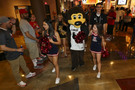 Chip the Buffalo gets some assistance locating the arena entrance from the University of Arizona cheer squad.