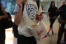 UCLA's Karsta Lowe enjoys some comfort food at the Beijing airport Sunday.