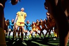 <p>Cal's Heather Walleigh gets her team hyped up to take the field. </p>