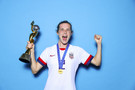 Tierna Davidson of the USA poses with the Women's World Cup trophy after the 2019 FIFA Women's World Cup France Final match between The United State of America and The Netherlands at Stade de Lyon on July 07, 2019 in Lyon, France.