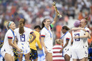 Alex Morgan and players of the USA celebrate with the trophy following the 2019 FIFA Women's World Cup France Final match between The United States of America and The Netherlands at Stade de Lyon on July 07, 2019 in Lyon, France.