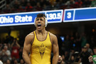 Arizona State's Zahid Valencia lets emotions take over after capping an undefeated season (32-0) with an NCAA title at 174 pounds.