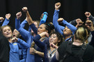 Picture Perfect! UCLA celebrates winning the national title after Christine Peng-Peng Lee helped raise the crown with a perfect 10.0 on beam.