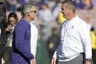 Washington head coach Chris Petersen talks with Ohio State head coach Urban Meyer prior to kickoff.