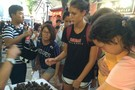 <p>WSU's Emmy Allen and ASU's Whitney Follette take in the local shopping scene at a traditonal outdoor market Monday in Beijing.</p>