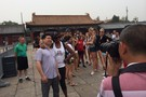 <p>Arizona assistant coach Charita Stubbs poses with a fan outside of the Forbidden City in Beijing on Wednesday.</p>