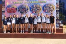 <p>The Pac-12 Volleyball All-Star Team poses Tuesday in front a promotional poster in Beijing highlighting the trip.</p>