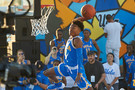 <p>UCLA freshman Jaylen Hands impresses teammates with a dunk.</p>