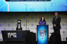 <p>Larry Scott and Washington's Yaz Farooq celebrate the Pac-12's 500th NCAA title</p>