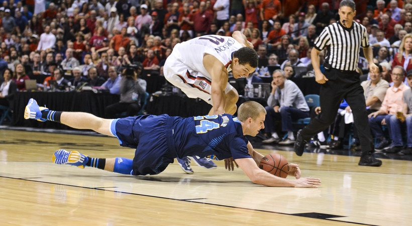 "<p>UCLA redshirt senior David Wear <a href=""http://pac-12.com/article/2014/03/15/2014-pac-12-tournament-bracket-update-uclas-travis-wear-dives-loose-ball"" target=""_blank"">hit the deck to snatch up a loose ball</a> ahead of Arizona's Aaron Gordon in the 2014 Pac-12 Men's Basketball Tournament championship game March 15 in Las Vegas. The Bruins needed every possession as they knocked off the Wildcats 75-71.</p>"