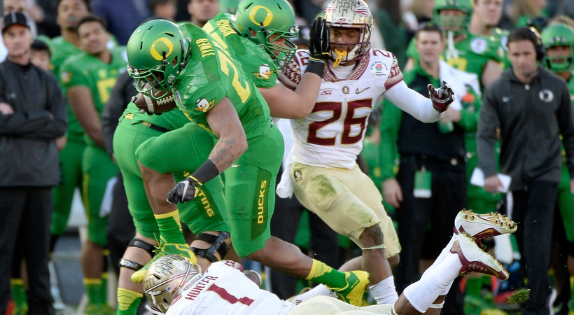 <p>Oregon running back Thomas Tyner runs over Florida State safety Tyler Hunter in the first half of Thursday's 2015 Rose Bowl Game.</p>