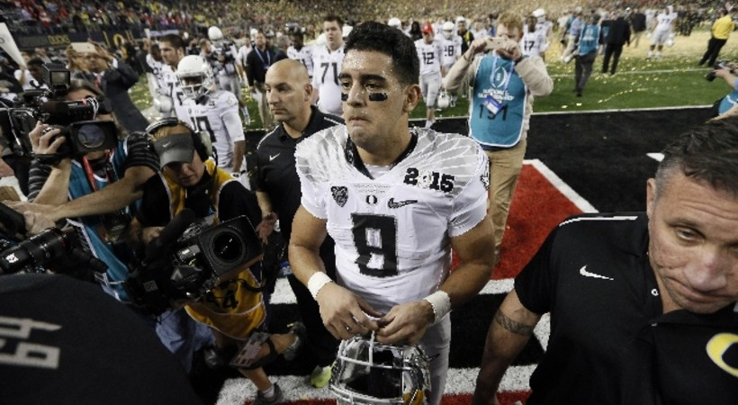 <p>An emotional Mariota leaves the field after the loss. </p>