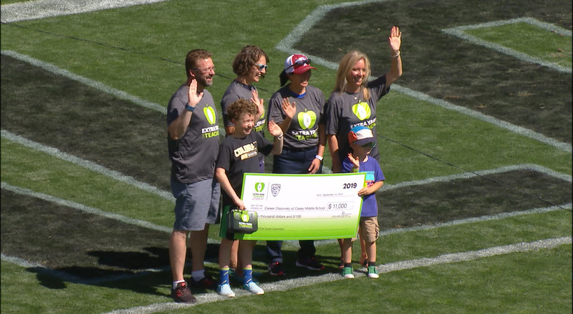 CU awards check to teachers at Casey Middle School in Boulder as part of Extra Yard for Teachers Week