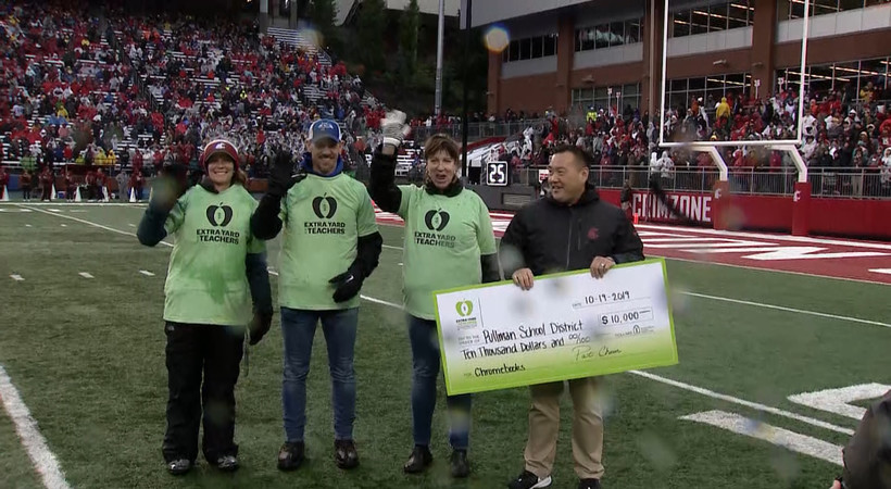Extra Yard for Teachers: WSU presents Pullman School District with $10,000 check