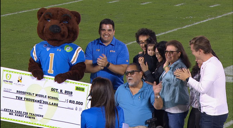 Extra Yard for Teachers: UCLA gifts check to Roosevelt Middle School's Randy Kamiya during OSU game