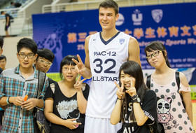 "<p>USC's Nikola Jovanovic took a moment for photos with local fans after the <a href=""http://pac-12.com/article/2014/08/13/pac-12-mens-basketball-all-star-team-rolls-past-chinese-university-all-stars"" target=""_blank"">Pac-12 all-stars defeated the Chinese university all-stars 73-47</a> Wednesday in Shanghai, China.</p>"