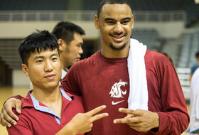"<p>Washington State's DaVonte Lacy posed with a local fan after the <a href=""http://pac-12.com/article/2014/08/13/pac-12-mens-basketball-all-star-team-rolls-past-chinese-university-all-stars"" target=""_blank"">Pac-12 all-stars defeated the Chinese university all-stars 73-47</a> Wednesday in Shanghai, China.</p>"
