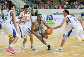 "<p>Washington's Andrew Andrews drove past a trio of Jiangsu Dragon defenders during the <a href=""http://pac-12.com/article/2014/08/14/pac-12-all-stars-stifle-jiangsu-85-63"" target=""_blank"">Pac-12 Men's Baskeball All-Star Team's 85-63 win</a> on Thursday in Nantong, China.</p>"