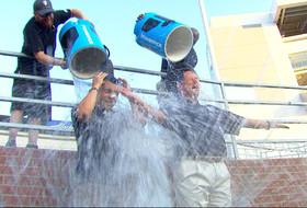 Video: Mike Yam and Rick Neuheisel take the Ice Bucket Challenge