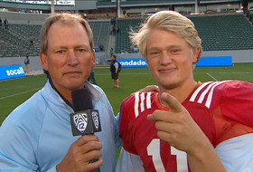 Rick Neuheisel interviews son Jerry following UCLA spring game