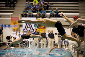 <p>Several swimmers entered the pool simultaneously during a relay race at the 2014 Pac-12 Men's Swimming Championships in Federal Way, Wash., in early March.</p>