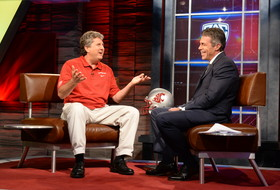 <p>Bristol, CT - July 24, 2013: Mike Leach, head coach of the Washington State Cougars and Chris Fowler during the 2013 Pac-12 Coaches on Campus Car Wash.</p>