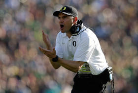 <p>Oregon head coach Mark Helfrich makes his point during the first half of the 2015 Rose Bowl Game Thursday.</p>