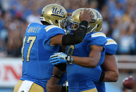 Quarterback Brett Hundley of the UCLA Bruins celebrates with wide receiver Jordan Payton  after Hundley scored on an 11 yard touchdown run in the second quarter against the Colorado Buffaloes at the Rose Bowl on November 2, 2013 in Pasadena, California. (Photo by Stephen Dunn/Getty Images)