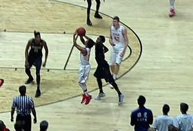 Highlight: Brandon Taylor nails buzzer-beating 3-pointer at half for Utah men's basketball