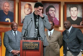 2014 Heisman Trophy award winner Marcus Mariota wipes away a tear during his acceptance speech.