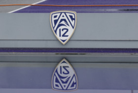 Pac-12 logo at steeplechase pit at Pac-12 Track & Field Championships in Seattle.