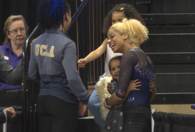 UCLA's Sophina DeJesus and Danusia Francis pause mid-meet to greet young fans