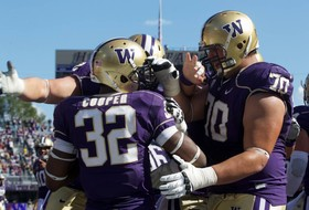 UW's Deontae Cooper scores the first touchdown of his career