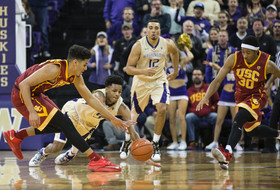 USC and WASHINGTON battle for a loose ball