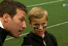 Kid calls successful running play at UW spring game